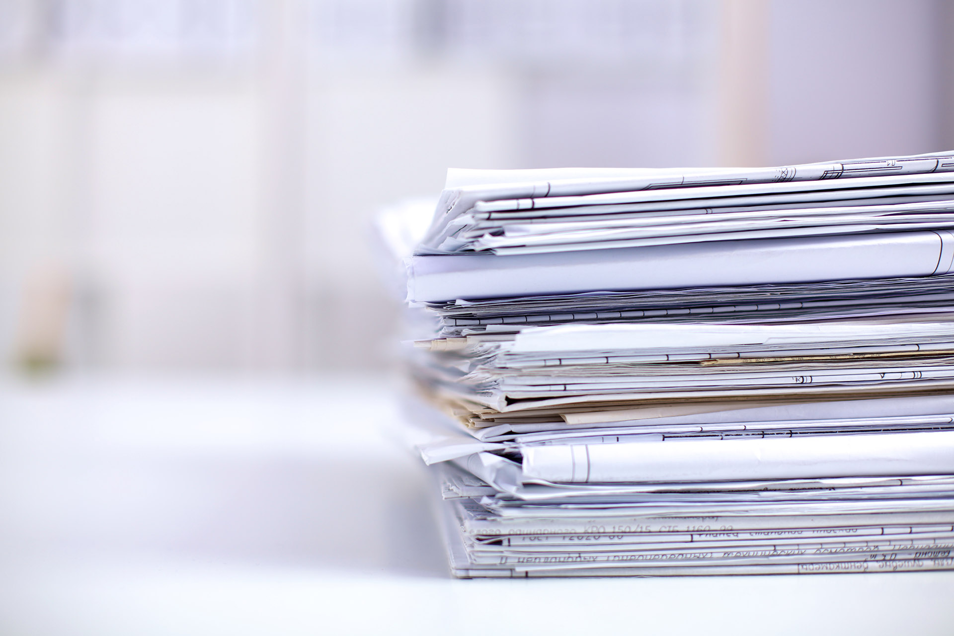 stack of documents and folders