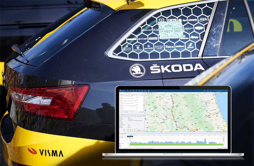Side view of the Skoda car with Visma logo sticker and a silver laptop at the front of the image showing Fleet Complete dashboard with fleet tracking map.