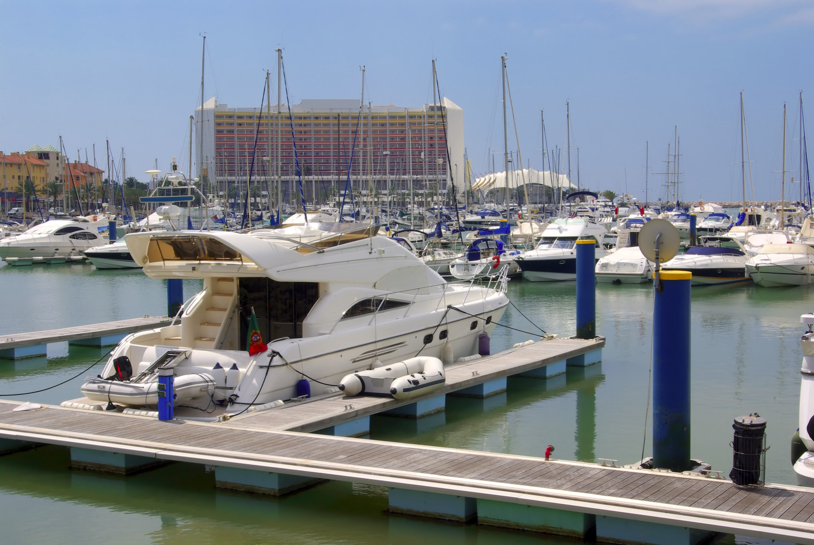 Power boat at the dock on water.