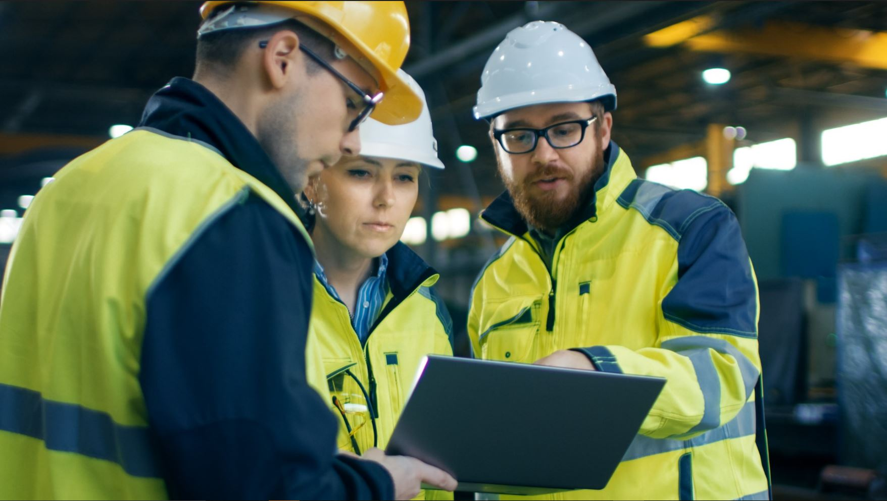 Safety workers looking at a digital board.